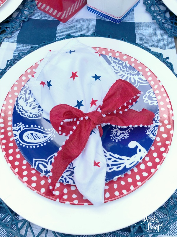 red, white and blue plates and napkins