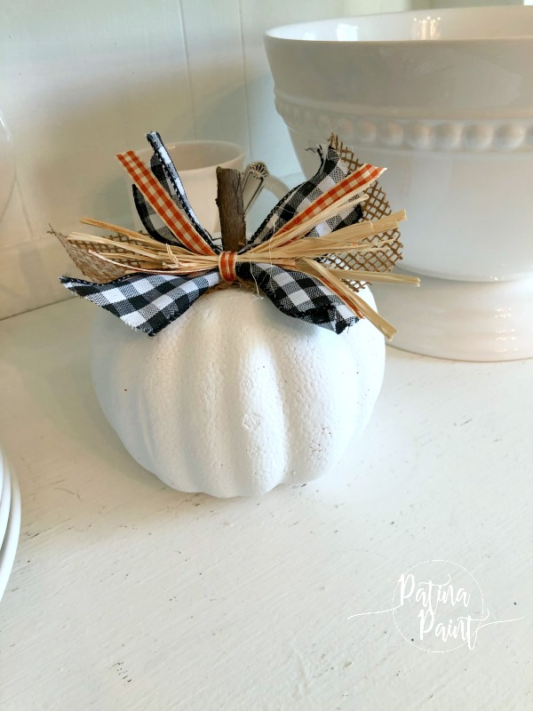 White pumpkin and ribbon