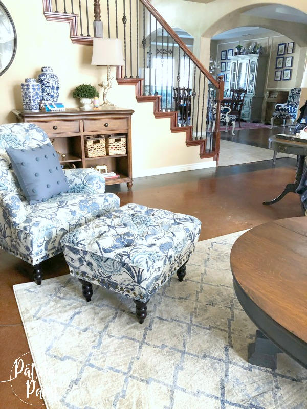 coffee table, chair, ottoman, stairs