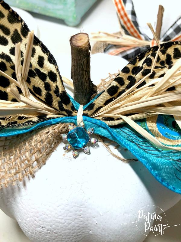 pumpkin, stick stem, ribbon and embellishment