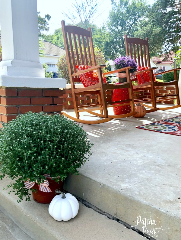 rocking chairs, porch, mums and pumpkins