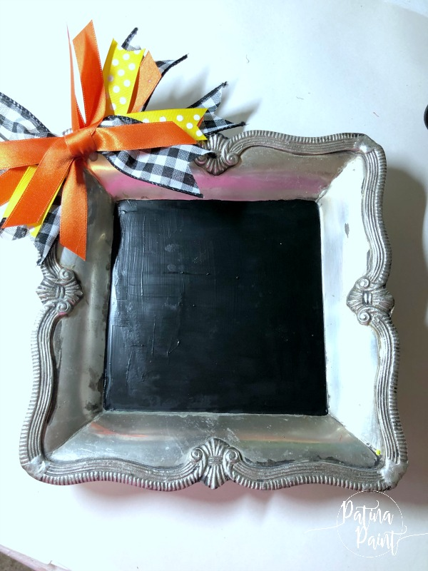 Silver tray with a bow